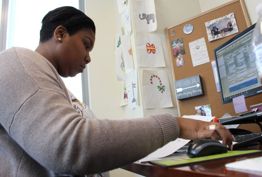 Jervon Lemon works at her desk at Children of the Fallen Patriot Foundation in Reston, VA. Lemon received a college scholarship recipient through the foundation, and is now ae scholarship administrator there. KEN-YON HARDY/STARS AND STRIPES