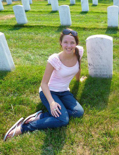 Bella Blackney at father's headstone.jpg