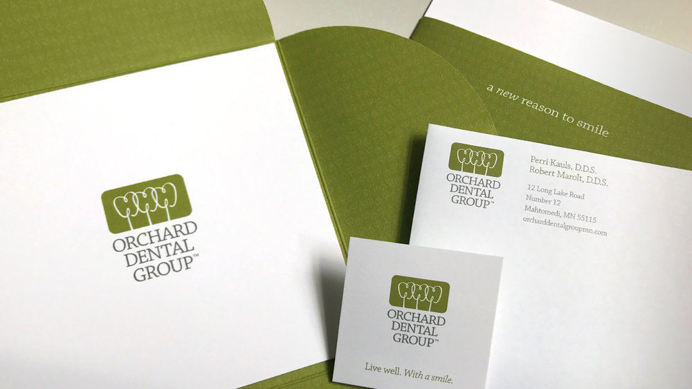 Orchard Dental Groups letterhead and appointment reminders.