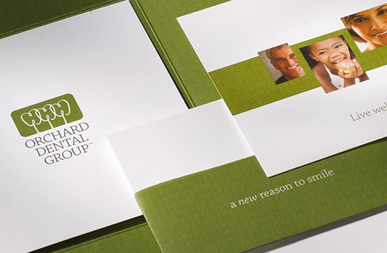 Orchard Dental Group brand identity on stationery system