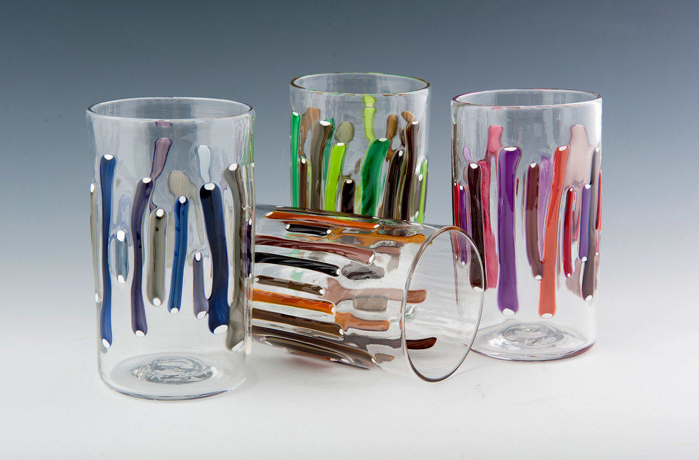 Stick Tumblers, seen here in Steel, Amber, Forest, and Berry (left to right).