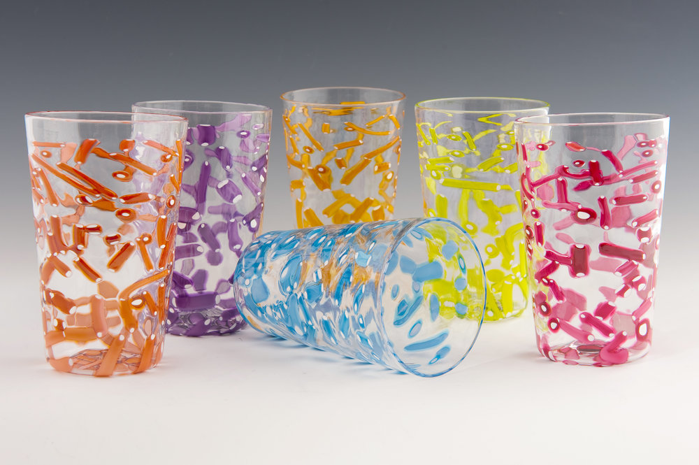 Honey Pint Glasses, seen here in Peach, Purple, Blue, Gold, Lime, and Red Jimmies (left to right).