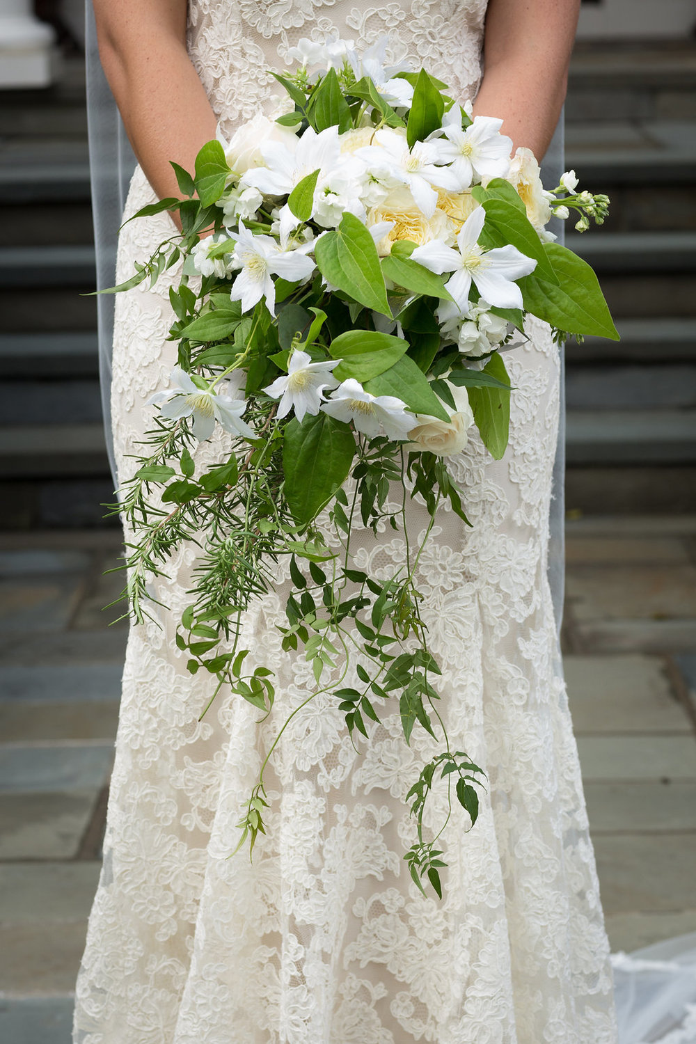 Summer wedding flowers in winston salem nc amy lynne originals the bride carried a cascading bouquet filled with garden roses clematis rosemary and jasmine the bridesmaids carried hand tied bouquets with pops of izmirmasajfo