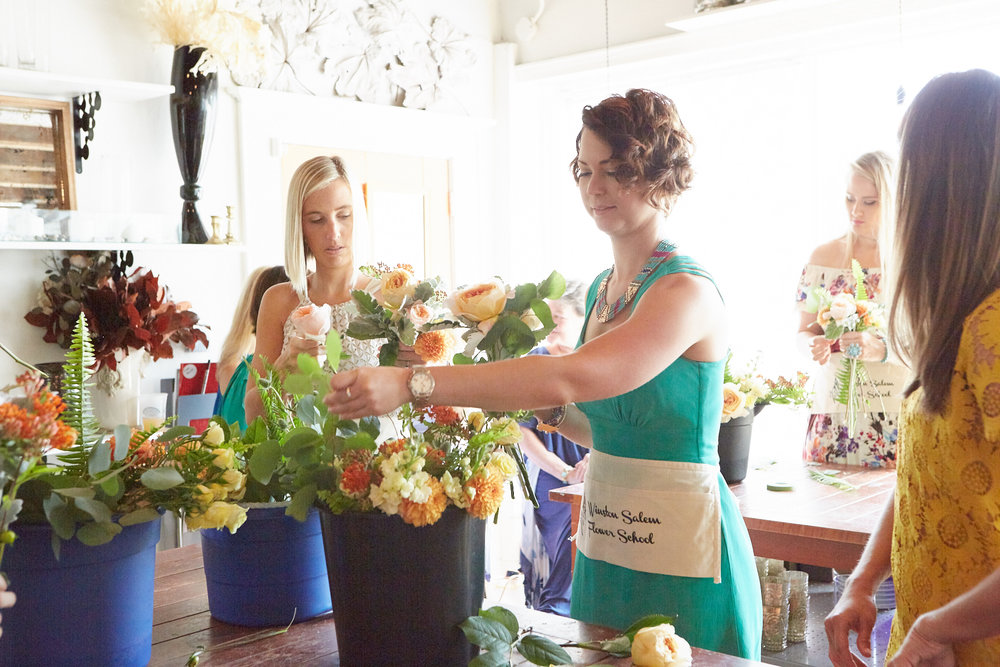 Each bridesmaids receives a bucket of flowers, clippers and a WSFS apron.  Let the designing begin!
