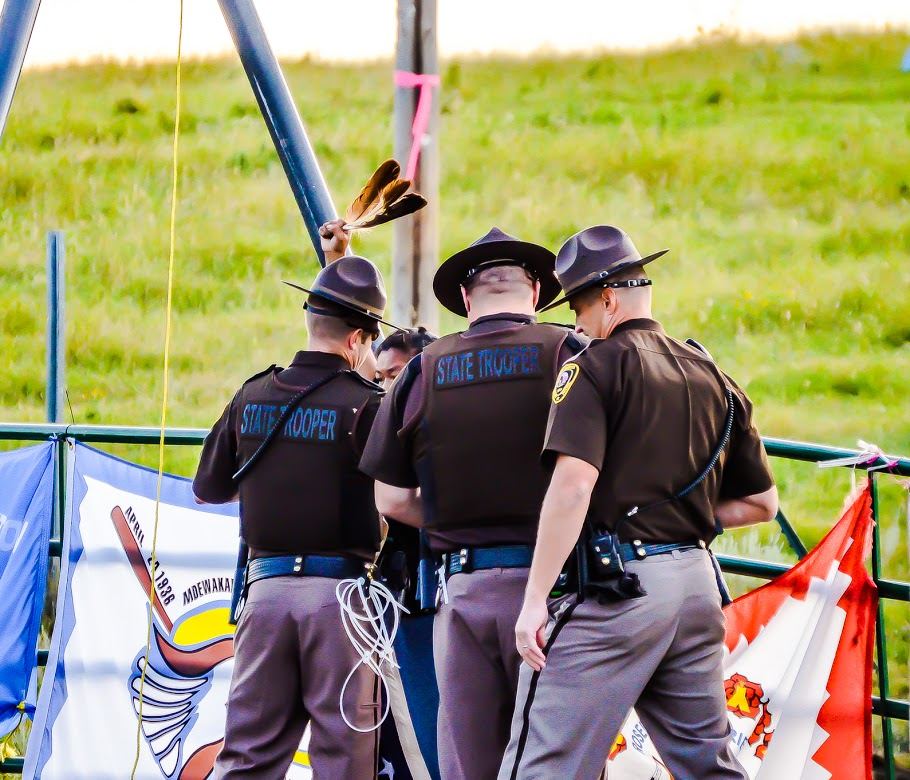 Monday, Aug 15, 2016 ND State Troopers surround and arrest an oppenent to the Dakota Access Pipeline. Rob Wilson