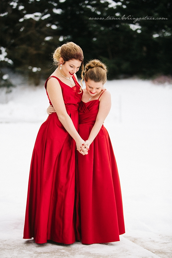 Flower girls in the snow wearing red gowns
