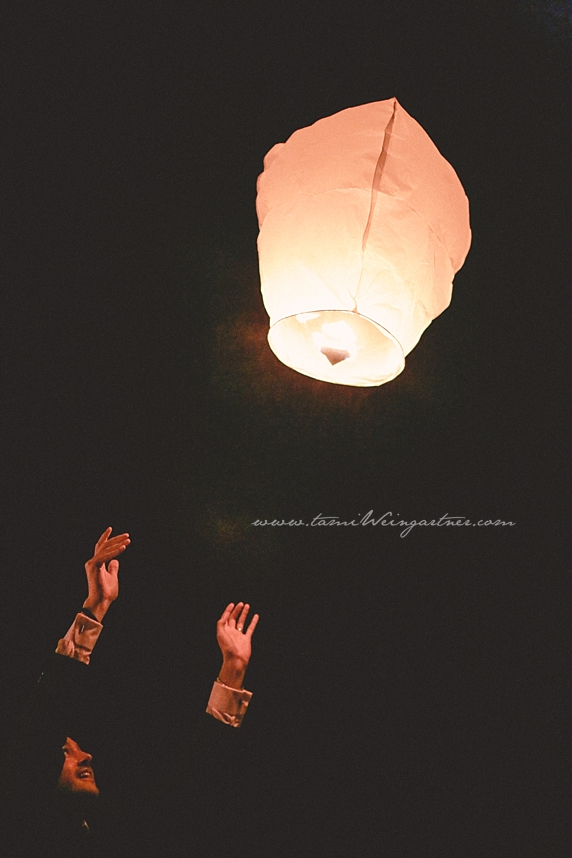 Guest releasing a lantern at a wedding in ligonier in the laurel highlands of pa