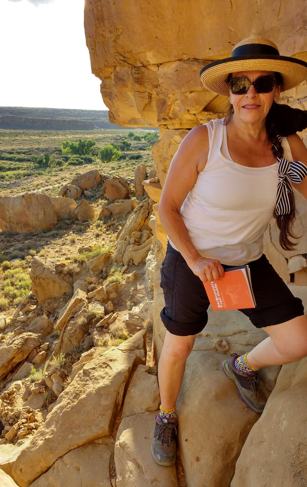 Harriete-climbing-a-crevice-chaco-canyon