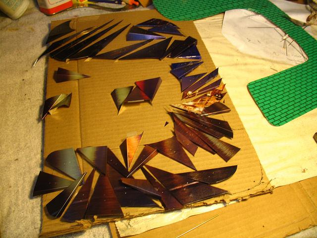 Working on another letter, cutting all the triangles.  It is a real challenge to create this metaphor for fracturing of society...and retain some level of organization.
