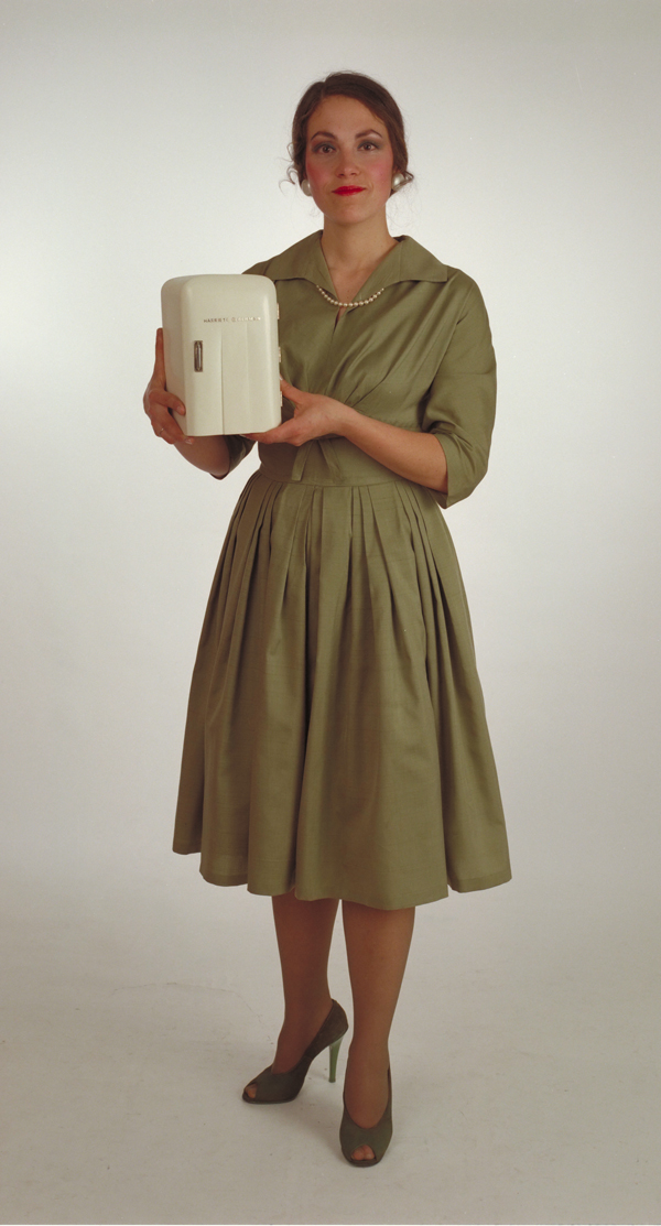 "Harriete Estel Berman dressed up in 1982 as the appliance lady holding the Appliances Sculpture ""Eating Out off a Refrigerator"""