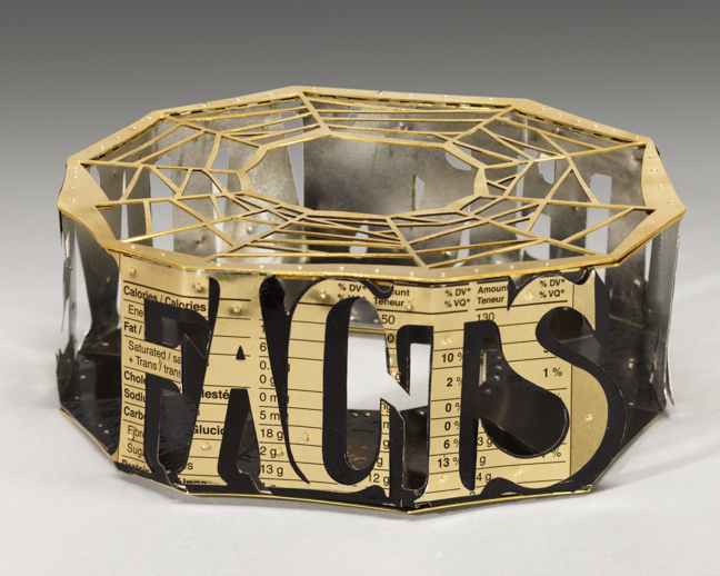"Alternative Facts  Bracelet is an insubstantial construction. The lettering is cut from recycled tin cans printed with Nutrition Facts. So much information these days has little foundation in the truth, yet it is bent and presented as fact.   Dimensions:    2"" x  5.5"" w  x 5.5"" depth"