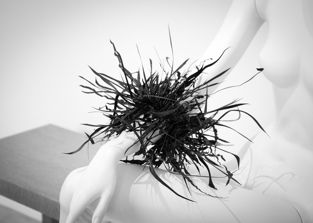 Black Plastic Recycle Bracelet on Mannequin