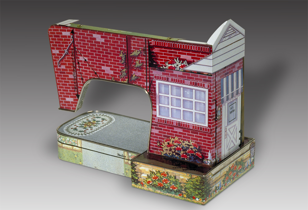 Fabrication sculpture that looks like a sewing machine and house
