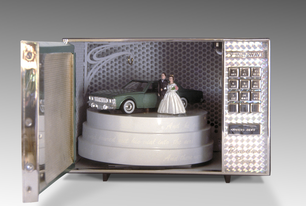 TV Microwave open view with wedding cake, bride groom, car