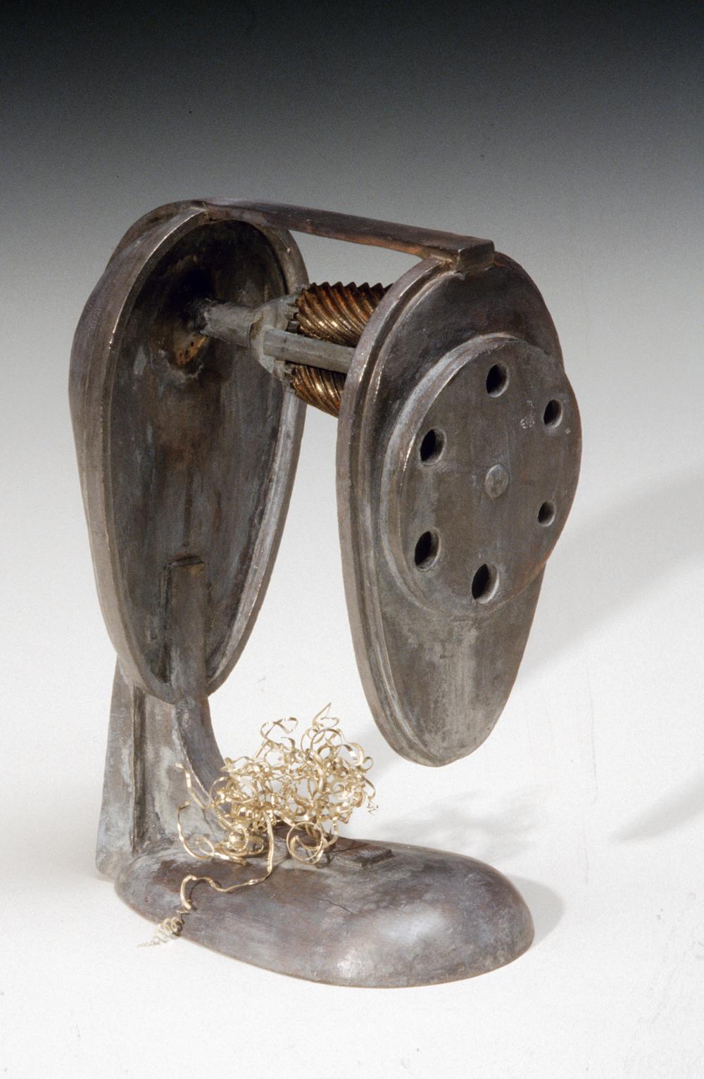 Metalgrammatic pencil sharpener sculpture about art criticism