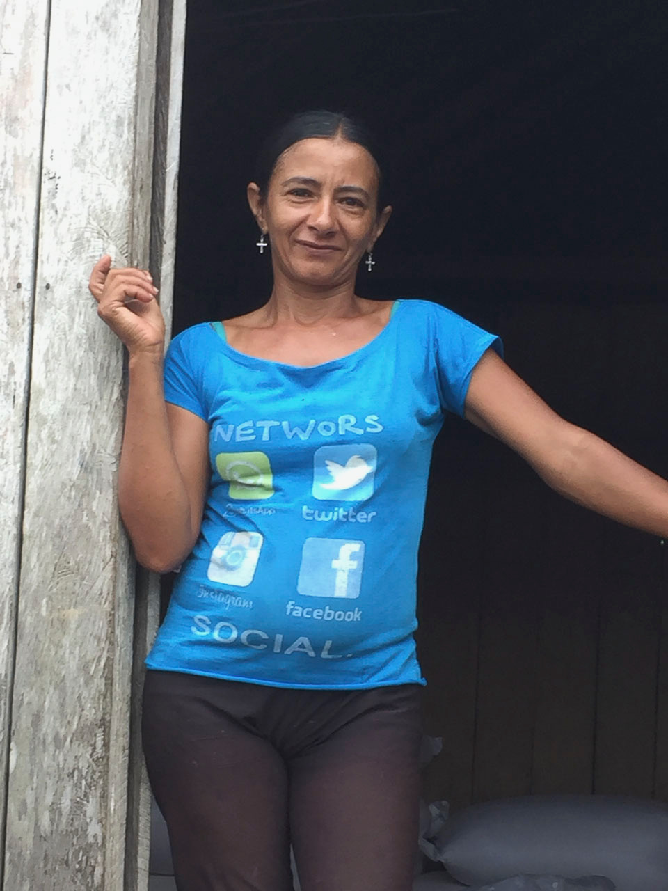 A local community member shows off her tech style in a village with no electricity.