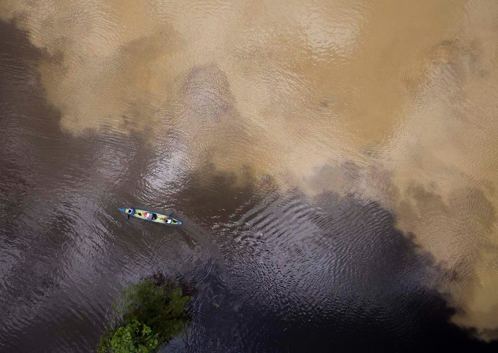 Houseboat Amazon survey boat makes the transition from white water varzea to black water igapo