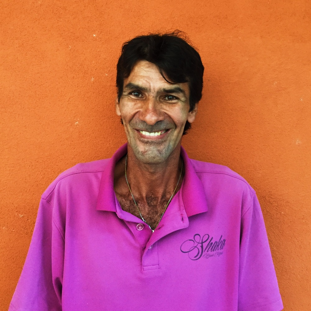 Carlos - Grounds-keeper, maintenance worker, & expert coconut-tree climber