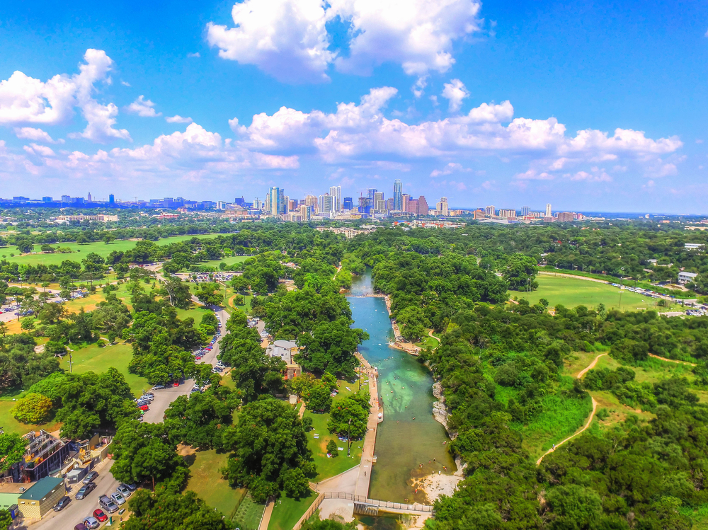 Aerial View of Barton Springs Pool and Austin Skyline