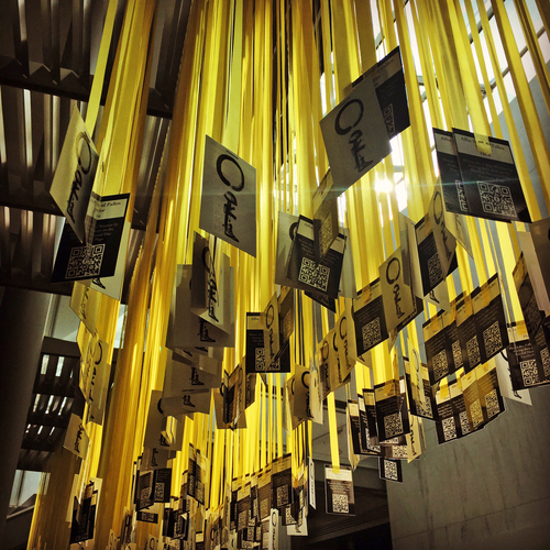 Fallen warrior cards and ribbons hanging inside the memorial