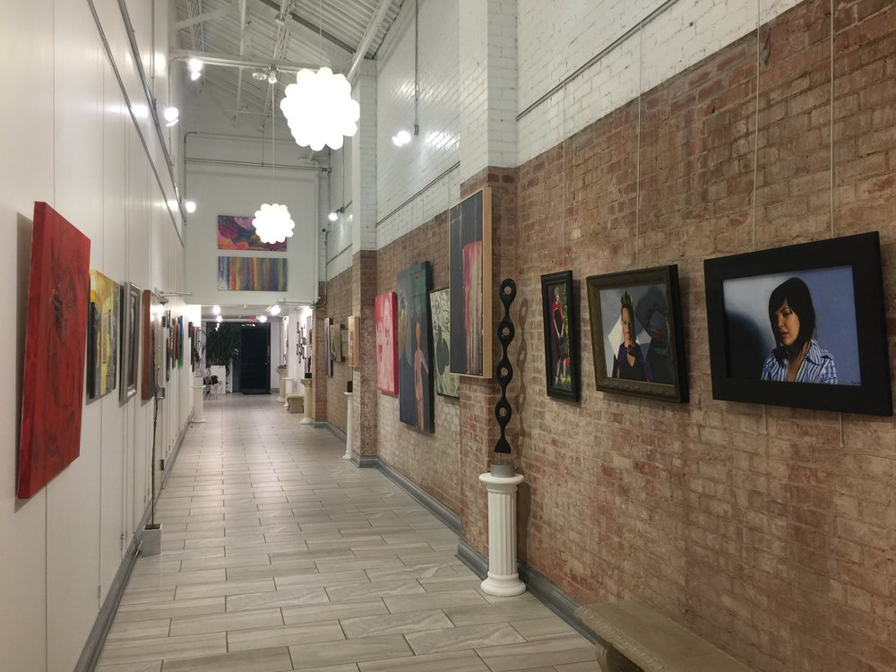 Installation view facing North, with painting by Teddi Fokas on the left and Ryan Pack on the right