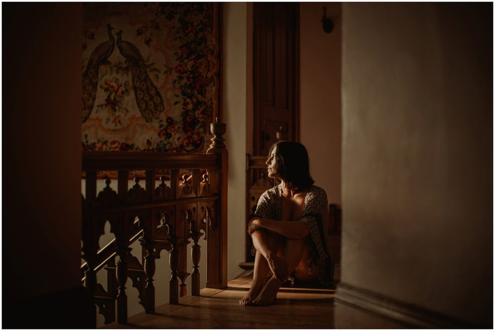 Milwaukee Boudoir Photographer | Woman sitting in sunlight.