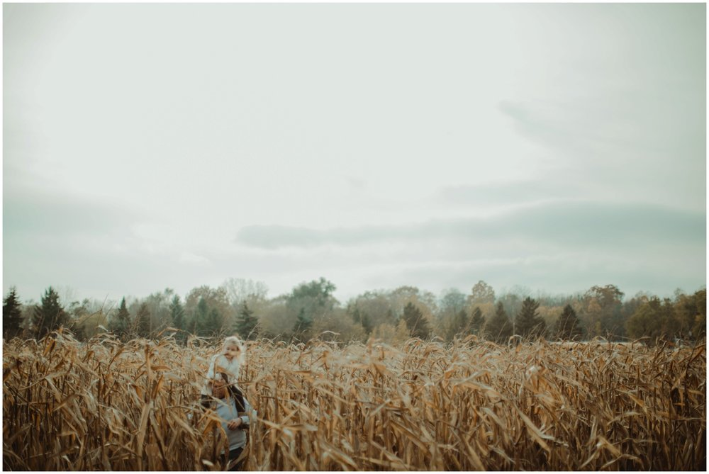 Milwaukee Family Photographer | Daddy and Daughter Session | Dad and Daughter piggy back ride through cornfield.