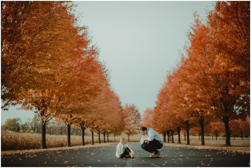 Milwaukee Family Photographer | Daddy and Daughter Session | Dad and Daughter sitting with fall colored trees.