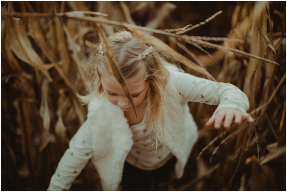Milwaukee Family Photographer | Daddy and Daughter Session | Young girl running through cornfield.