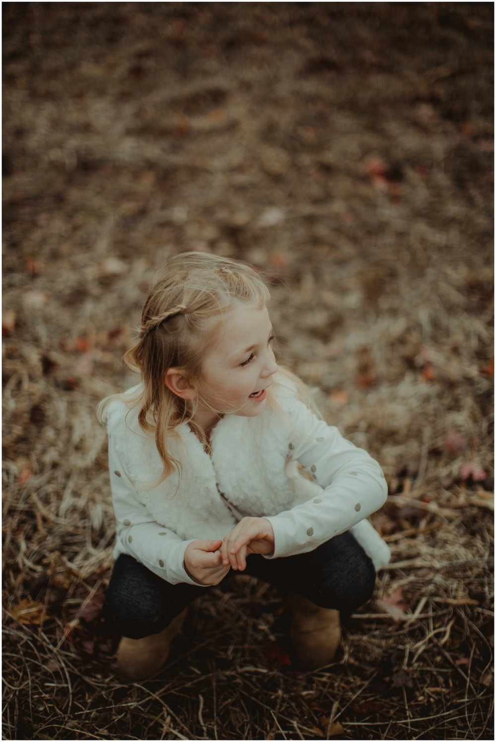 Milwaukee Family Photographer | Daddy and Daughter Fall Session | Young girl picking seeds.