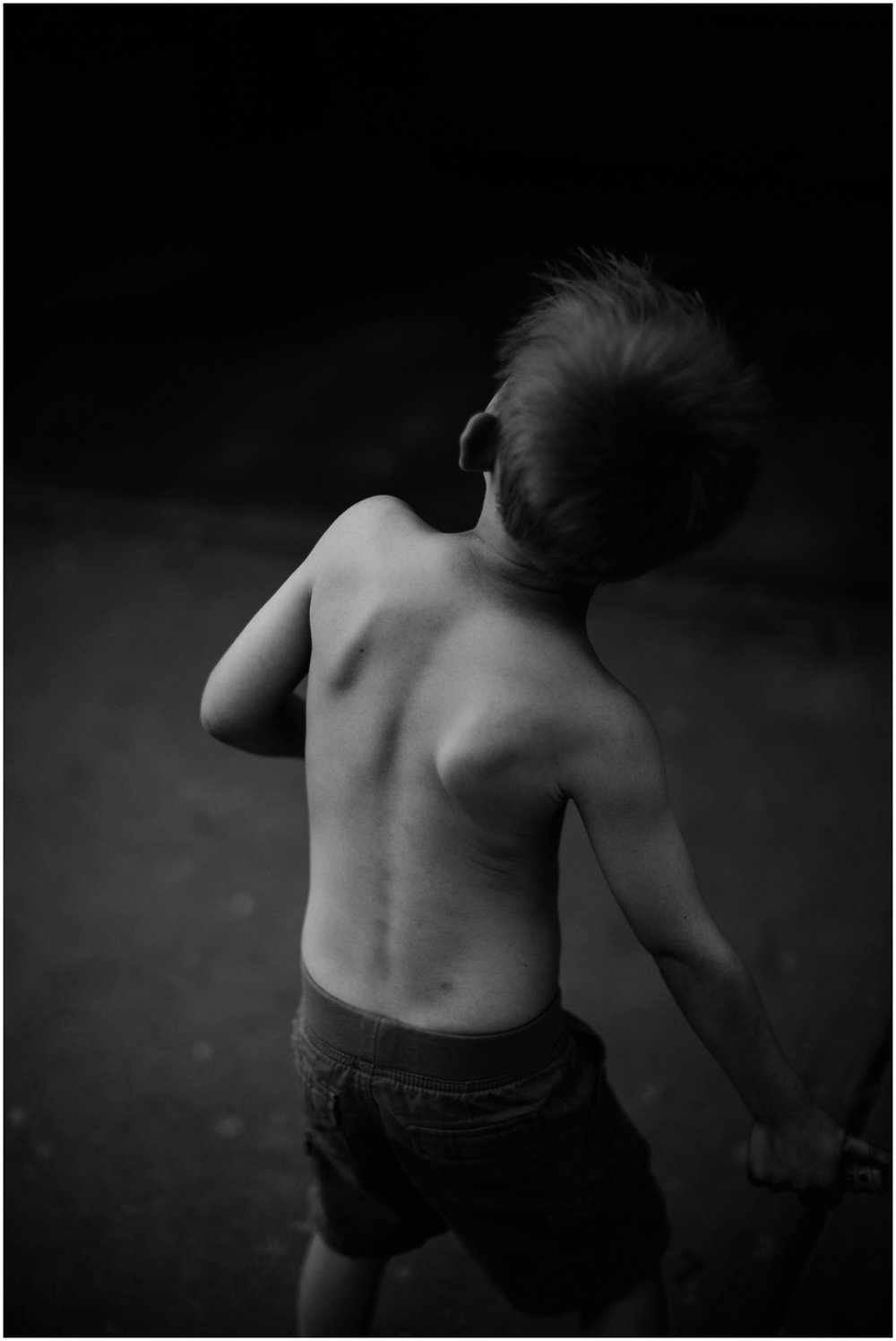 Milwaukee Lifestyle Photographer | Documentary photography of young boy's childhood | Boy throwing.