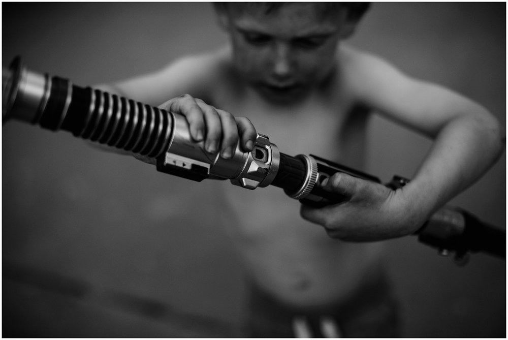 Milwaukee Lifestyle Photographer | Documentary photography of young boy's childhood | Boy with light saber.