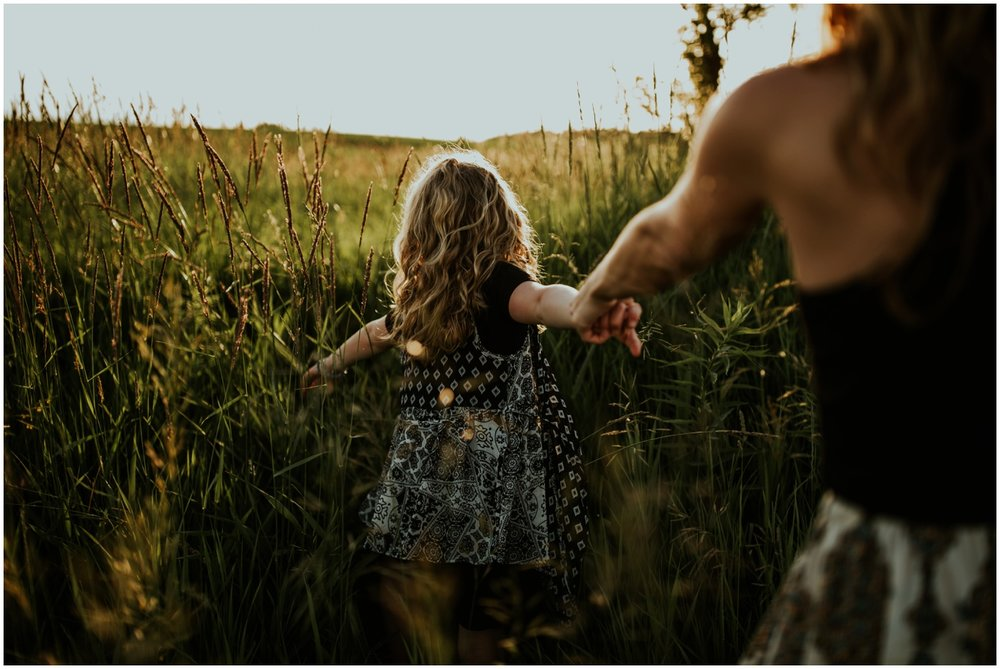 Milwaukee, Wisconsin Family Photographer | Mama and Me Session | Daughter leading mom through field.