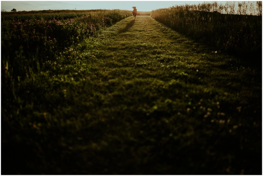Milwaukee, Wisconsin Family Photographer | Mama and Me Session | Young girl running through grass at sunset.