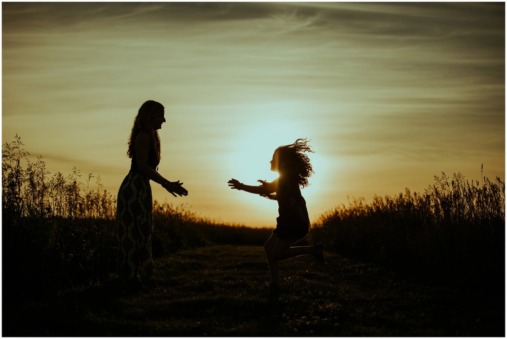 Milwaukee, Wisconsin Family Photographer | Mama and Me Session | Silhouette of daughter jumping into mother's arms.