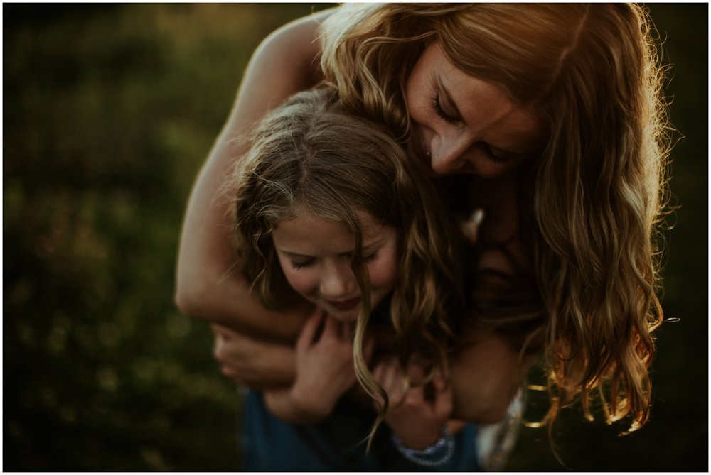 Milwaukee, Wisconsin Family Photographer | Mama and Me Session | Mom's arms wrapped around little girl.