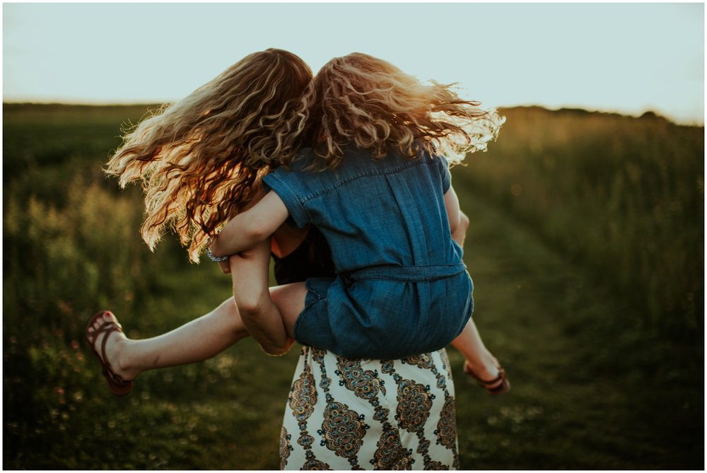 Milwaukee, Wisconsin Family Photographer | Mama and Me Session | Mom giving daughter piggy back ride.