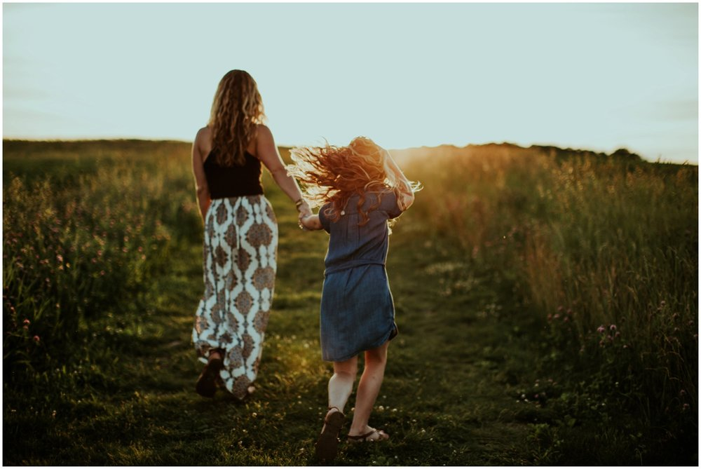 Milwaukee, Wisconsin Family Photographer | Mama and Me Session | Mom and daughter running through field.