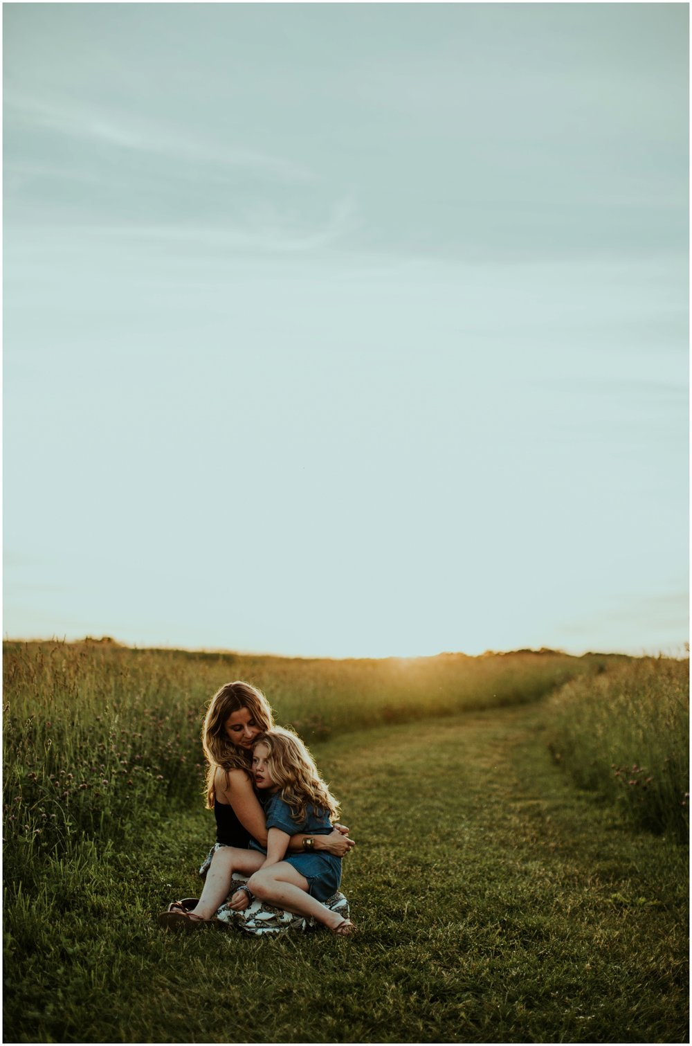 Milwaukee, Wisconsin Family Photographer | Mama and Me Session | Mom and daughter sitting in field.