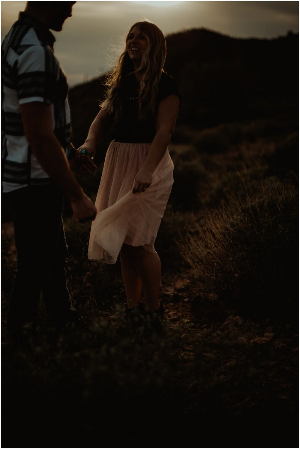 Superstition Mountain Engagement Photos // Arizona Desert Engagement // Dark and dreamy image of couple on a mountain.