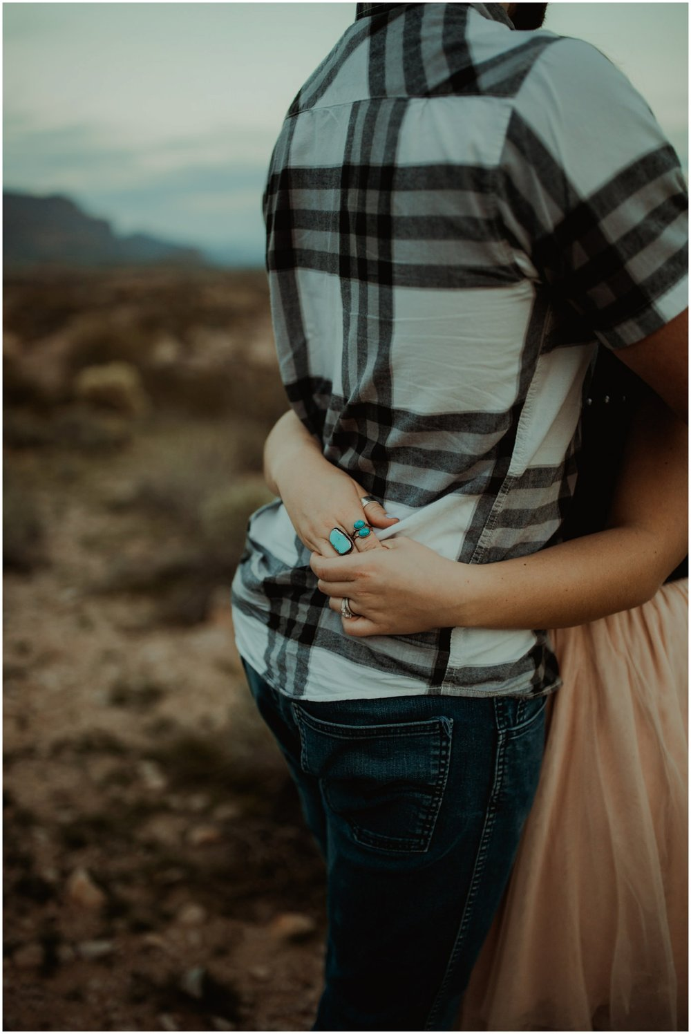Superstition Mountain Engagement Photos // Arizona Desert Engagement // Wraps her arms around his waist.
