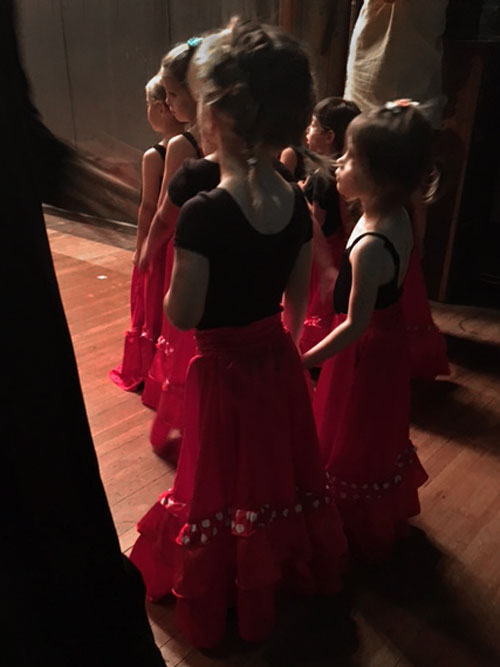 Kids in the theater wings before a performance.  Students at the Pink Flamenco Children's Academy and Austin Flamenco Academy all have the opportunity to perform at least once a year.