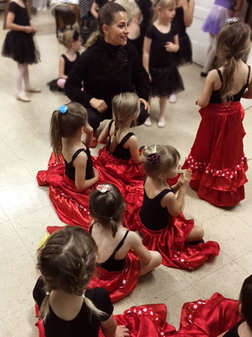 Genoveva with kids before a performance.  Students at the Pink Flamenco Children's Academy and Austin Flamenco Academy all have the opportunity to perform at least once a year.