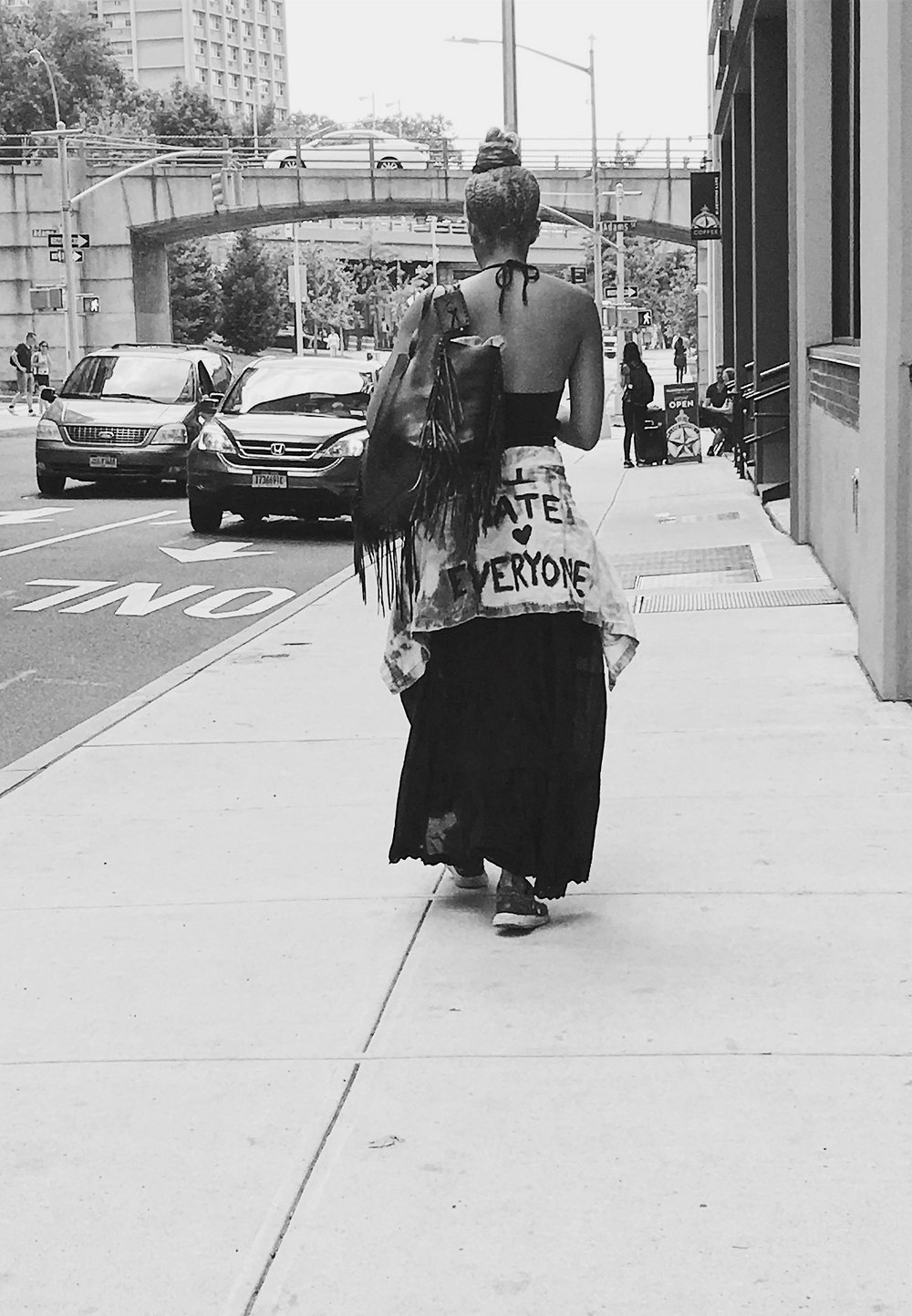 A New Yorker on a hot summer day, dressed in black with a personal fashion statement  {...love everyone}