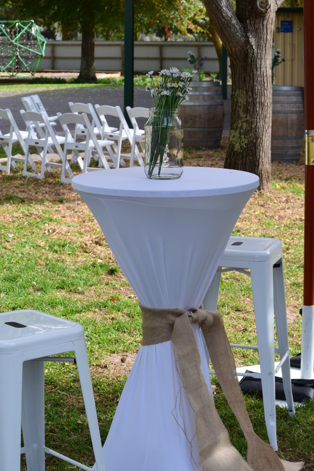 Bar Tables with White Lycra Covers $30 and White Tolix Stools $14