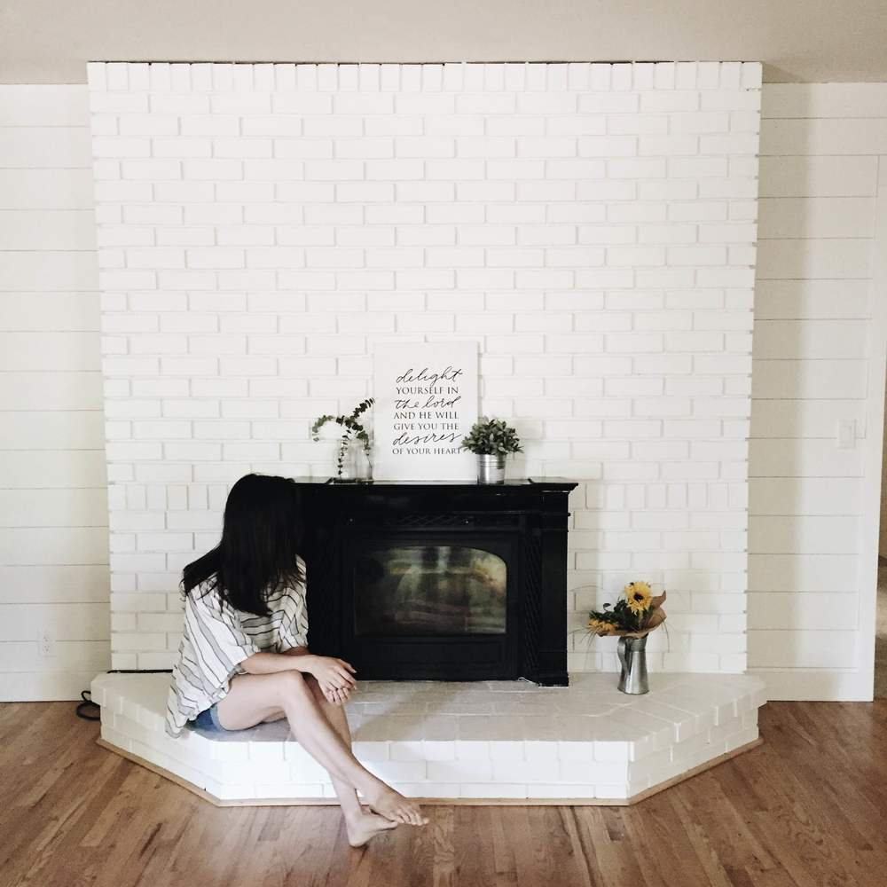 Beautiful right? I'm glad we decided to go all white. I think because our brick was so red, when we put the first layer of white (white washed style) it actually made our fire place look blue! Going full out white made it clean, modern, and lovely!