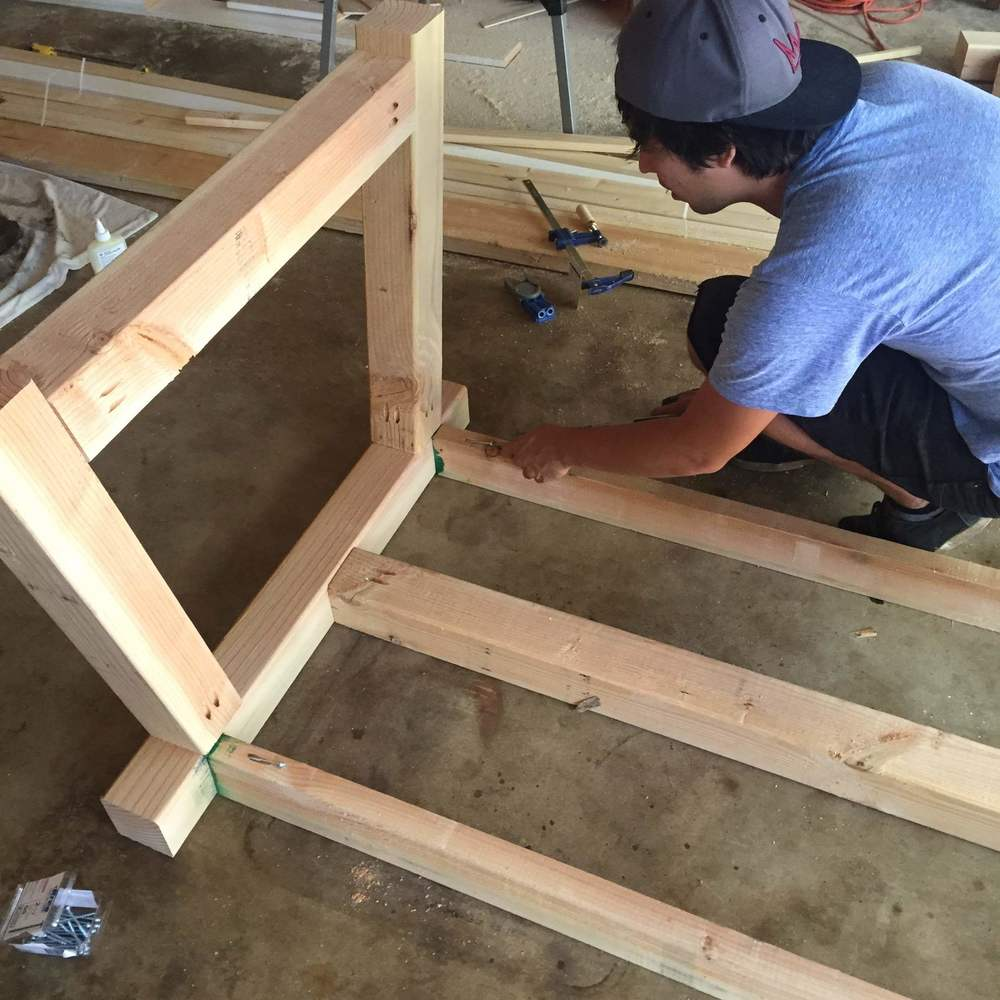While the legs are still flipped over, we attached the outside 2x4's  Note: We are attaching the top of the table **