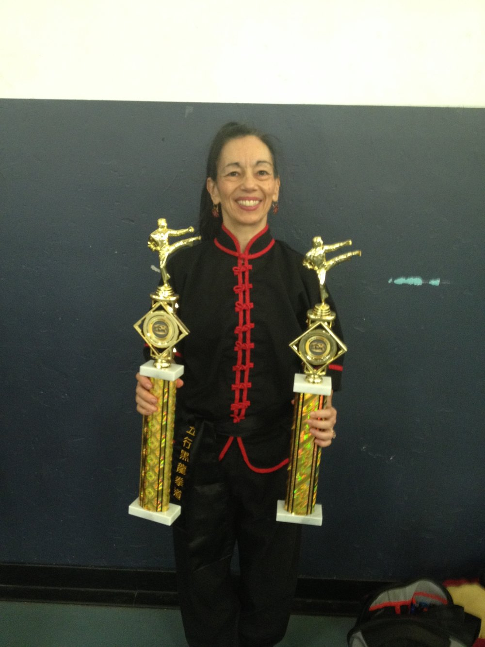 Sharon w. smaller trophies later replaced by approp. 2d place trophies for KF weapons and forms.jpg