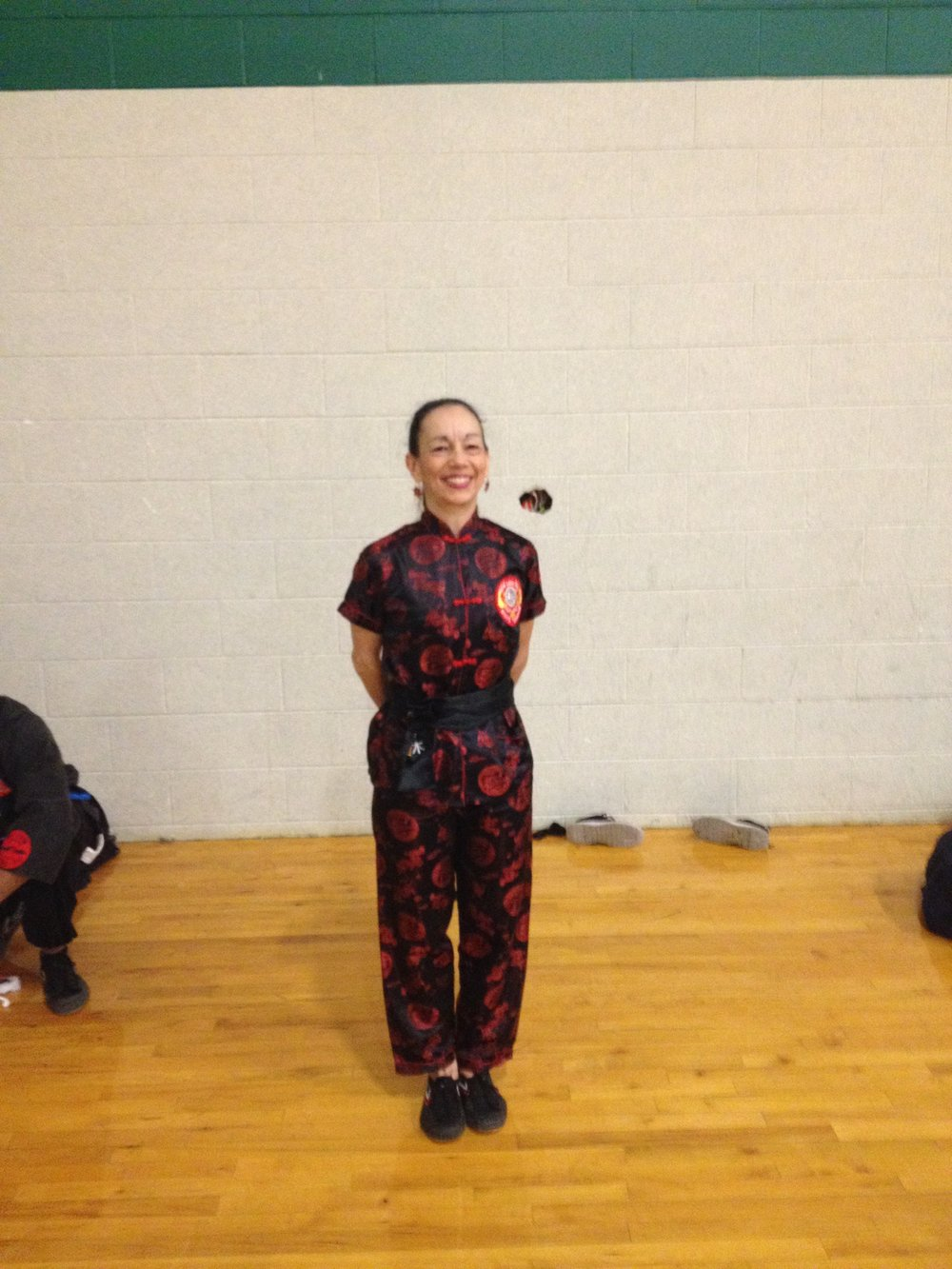 Sharon Montella wins First Place at  World Martial Arts Federation Karate Kung Fu Tournament -  Advanced Weapons with Pai Lum Plum Sword Form.jpg