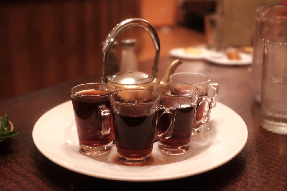 "Of course, no meal in the Middle East would be complete without some tea.  Try it with mint and 3+ spoons of sugar if you want to drink it like a ""local."""